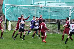 Linlithgow Rose have to cope with some Newburgh pressure. Pic by Graham Strachan.