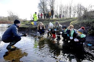 Pascal Lovell leads the fish fry release at the White Cart Water, Pollok Country Park, with pupils.