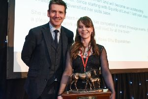Laura pictured receiving her award from Dougie Vipond.