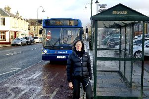 Dr Janet Moxley next to bus stop on Biggar High Street