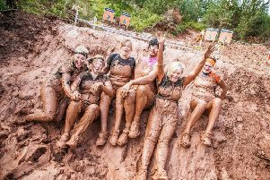 These competitors have just completed the Barby obstacle - crawling under barbed wire
