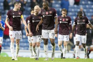 John Souttar, left, and the Hearts players' dejection was clear to see after their unbeaten start to the season ended at Ibrox