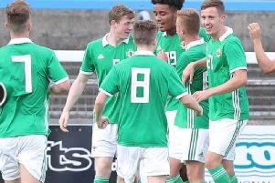 Tom (first right) celebrates a Northern Ireland under-19s goal. The team is bossed by ex-Hearts ace Stephen Frail.