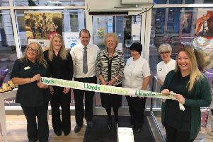 The re-opening ceremony was conducted by (centre) Mrs Marion Gilchrist, the veteran Carluke businesswoman