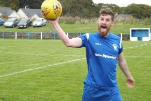 Hugh (Shug) Kerr celebrates with the match ball after scoring a hat-trick against Ardeer Thistle earlier this season