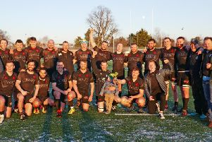 Biggar Rugby Club head coach Gary Mercer (second right) and his jubilant players celebrate their 12-10 success at Highland on Saturday (Pic by Nigel Pacey)