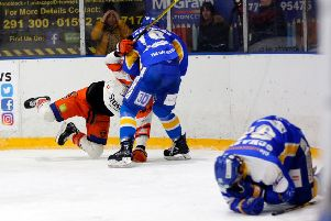 Chase Schaber lies injured on the ice after a hit in the game versus Sheffield Steelers (Pic: Steve Gunn)