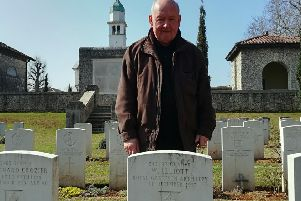 Jack, standing by the gravestone of his fallen grandfather.