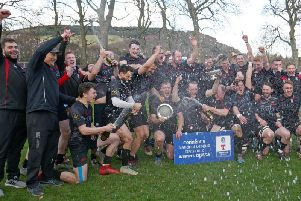 Biggar Rugby Club head coach Gary Mercer (2nd left) celebrates this seasons runaway Tennents National League Division 2 title success with his jubilant squad (Pic by Nigel Pacey)