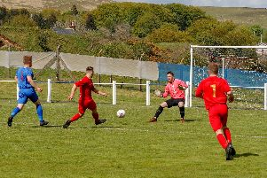 Ciaran Lafferty slots in his fourth goal at Muirkirk (Pic by Kevin Ramage)