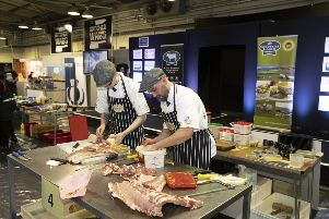Displaying cutting edge skills, Alan and Sean of Ramsay's of Carluke at the Butcher Wars event.