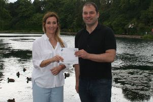 C3 Chair Roy Provan receiving the generous donation from Laura Malloy, President of East Renfrewshire Chamber of Commerce