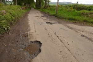 Potholes on Couper's Road at the Upper Park junction