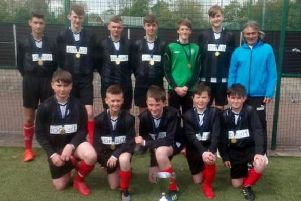 The victorious Lanark Grammar squad are pictured with team manager Johnny Gardiner (Submitted pic)