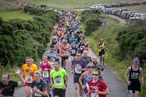 The trail of runners snakes its way back at Chapelton