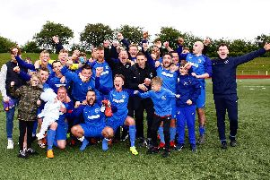 Carluke Rovers celebrate winning promotion at John Cumming Stadium in May