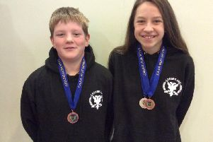 Justin and Millie with medals (Pic by Stuart Stevenson)