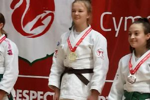 Lily Rafferty (centre) with her Welsh Open gold medal (Submitted pic)