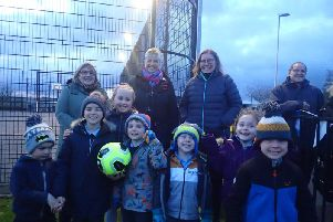 Pictured are Catherine McGurk (Levenseat Trust), Councillor Catherine McClymont, Pat Mavor (WAT IF?) and children from Auchengray Primary School.