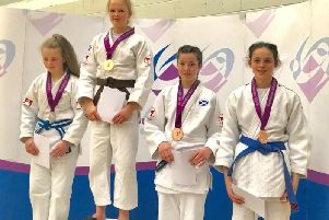 Lily on the winner's podium in Motherwell (Submitted pic)