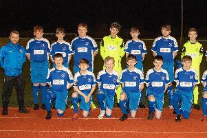 Head coach Paul Skelton (1st left) is pictured with some of the Carluke Rovers Youth Academy 2005s squad, sponsored by OMNI Interior Solutions and OMNI core drilling specialists.