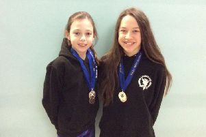 Evi Mackie and Millie McArthur were both in medal-winning form at the West District Long Course Championships
