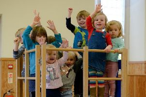 Save our playgroup say the childern of St Nicholas, at play in their church hall