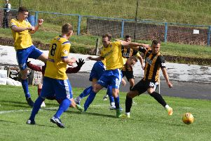 Kevin Smith comes up against the Cowden defence