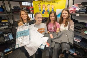 From left: Lynn McClelland from Scottish Friendly, Emily, Jessica and Nicola Cramond, the founder of the South Ayrshire Clothing Bank. (Photo: Peter Devlin)