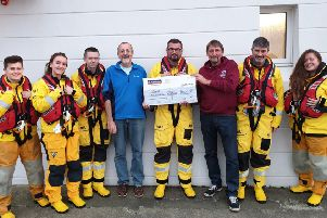 Cameron and William Kerr presenting the cheque. (photo: RNLI/Craig Sommerville)