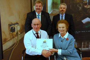 Pictured top at the awards ceremony are: Norman Kerr, OBE Director of Energy Action Scotland and  Stewart Wilson, TIG CEO.   Pictured bottom  are: Donald Mackinnon, TIG Depute CEO and  Baroness Helen Liddell.