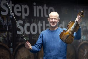 Alistair McCulloch plays the Gregg violin, which is believed to have been played by Robert Burns more than 250 years ago. ''(Photo: Lesley Martin)