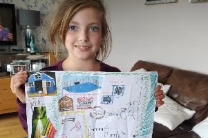 Grace Kenny shows off her winning entry in the Rennie Road Community Alliance 'design your play park' competition
