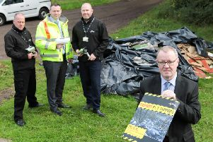 Councillor Michael McPake and staff from the council's environmental protection team highlight an example of flytipping causing an eye sore in North Lanarkshire