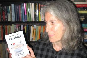 Deedee Cuddihy with a copy of 'The Wee Guide to Porridge'.