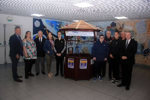 New College Lanarkshire staff and students hand over wishing well to Rotary Club of Cumbernauld which is located in Cumbernauld town centre to raise funds for good causes