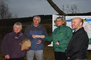 Carol McGinnes from Forest Enterprise Scotland and Neil Ritch from Big Lottery hand over title for the Carron Valley Community Woodland and to Peter Hayward of the community council and Margaret Porter of Valley Renewables Group