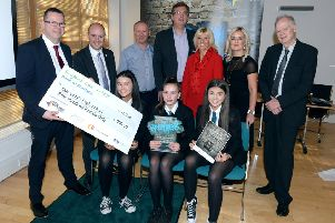 The Our Lady's High winning team of Erin O'Brien, Maria Roos and Lucy McNee with head teacher Danny McNulty, Councillor Frank McNally (convener of Education), Dragons Danny Murphy, Scott Webb, Denise Canning and Joanne Telfer, and Councillor Allan Graham (convener of the Enterprise and Housing Committee)