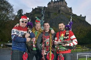 Red hot winter woollies...the Red Hot Chilli Pipers are among the Scottish celebrities who will be joining thousands of people across Scotland tomorrow taking part in Save The Children's annual Christmas Jumper Day.