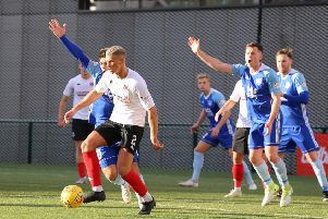 Tom Lang in action against promotion rivals Peterhead
