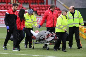 Clyde skipper Kevin Nicoll is stretchered off during last week's win over Albion Rovers (pic by Craig Black Photography)