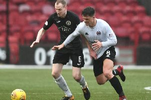Chris McStay and Clyde battled to three vital points against Marc Laird and Edinburgh City (pic by John Devlin)
