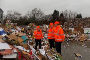 Stuart McDonald MP reviewing recyclable material at the DH Smith depot in Kilsyth