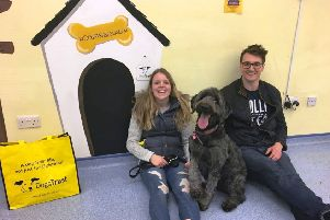 Claire and David with Poppy, the 100th dog to be found a new home by the Dogs Trust in Glasgow this year.
