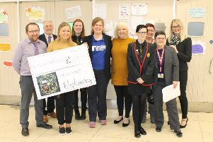 Staff and pupils from Kilsyth Academy present the cheque to Emma Vickerstaff of Teenage Cancer Trust (centre left), joined by Nicole Lowther (second left) and her mum Lorraine (centre right)