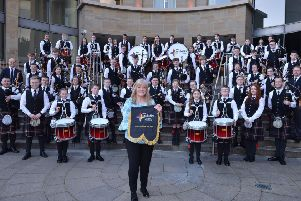 UK Steel Enterprise regional manager Anne Clyde with North Lanarkshire Schools' Pipe Bands at Glasgow Royal Concert Hall