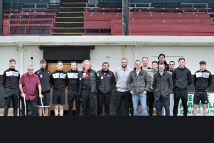 Chair of Y Suffer in Silence, Paul Greenall, with members of Fraserburgh FC and local councillor Brian Topping