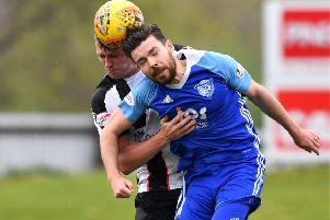 Peterhead's Ryan Dow challenges with Elgin's James McGovern (Pic by Duncan Brown)