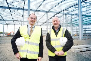 Willie Scanlon (left), property development manager of Farmfoods, and  Richard Bowden, special projects director at ISD Solutions at a major new distribution centre next to the Farmfoods HQ in Cumbernauld.