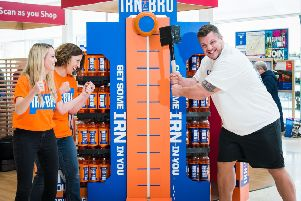 Luke Stoltman tests his strength on a visit to Tesco Extra in Cumbernauld